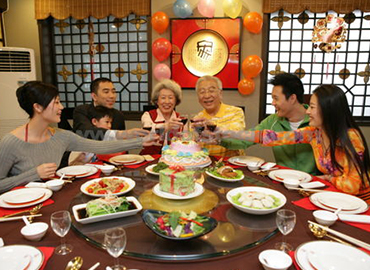 Chinese New Year Tradition showing reunion dinner